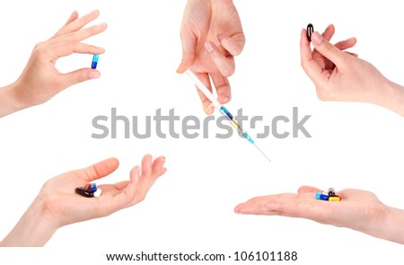 hand of a woman holding a pill, isolated against white background - stock photo