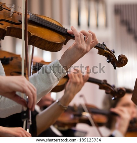Hand of a woman playing the violin - stock photo