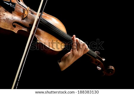 Hand of a woman playing the violin on a black background - stock photo
