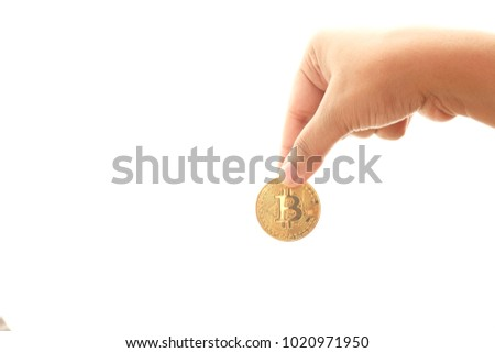 Hand of a women holding bitcoin isolated with white.