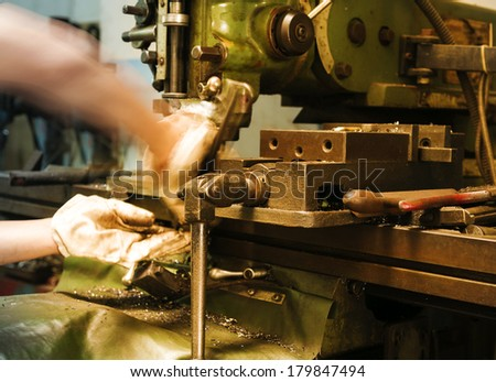 Hand of a worker in a hard job - stock photo