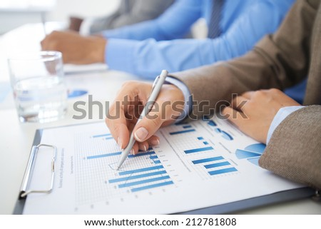 Hand of a young businesswoman analyzing chart