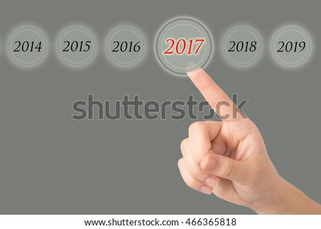 Hand of a young girl points to a figures 2017.