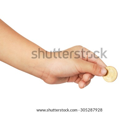 hand of a young kid holding a coin - stock photo