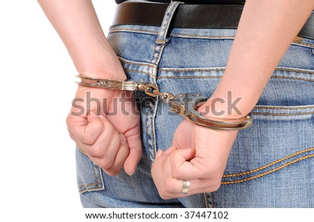 Hand of a young woman in handcuffs