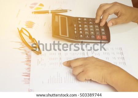 Hand of accountant checking financial document