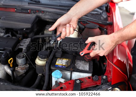 Hand of auto mechanic. Car repair service.