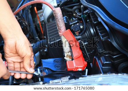 Hand of auto mechanic. Car repair service - stock photo