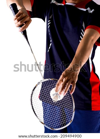 hand of badminton player with racket and shuttlecock - stock photo