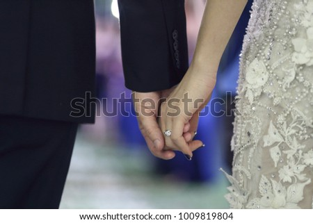hand of bride and groom in wedding ceremony