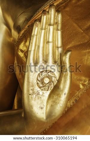 Hand of Buddha statue - stock photo