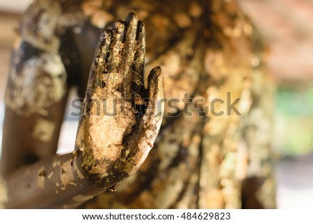 Hand of Buddha statue in old Thailand temple