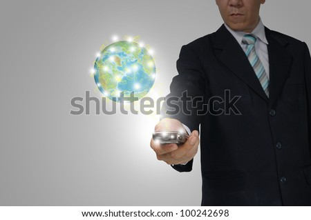 Hand of Business Man Hold touch screen of smartphone sending e-mail to earth globe. Elements of this image furnished by NASA - stock photo