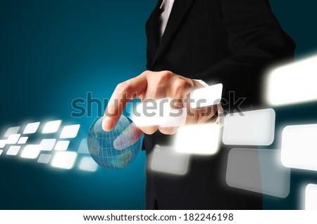 Hand of Business Man Pick earth globe - stock photo