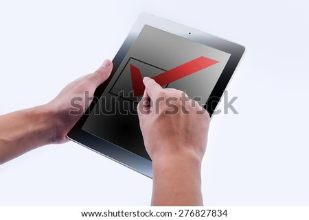 Hand of Business Man point check mark option and box on Touch screen of Tablet PC  - stock photo