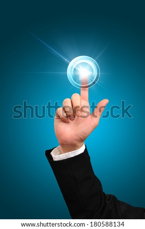 Hand of Business man pushing start button or play button - stock photo