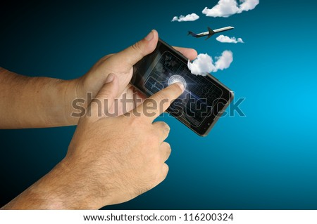 Hand of Business man touch smart phone with plane and cloud - stock photo