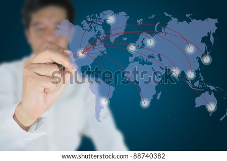 Hand of business man write a communication chart on tablet pc touch screen