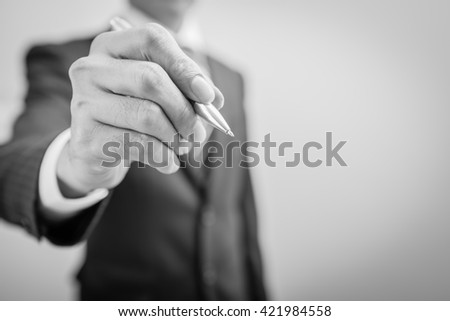 Hand of business man write or writing. - stock photo