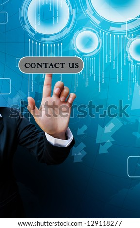 hand of business women pushing a button on a touch screen interface on contact us button on background blue