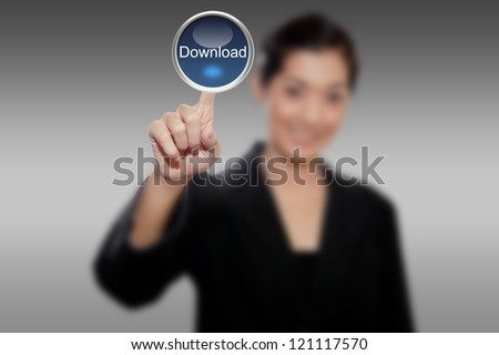 hand of business women pushing a download button a touch screen interface