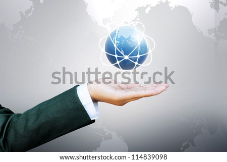 hand of business women pushing world and a button on a touch screen interface - stock photo