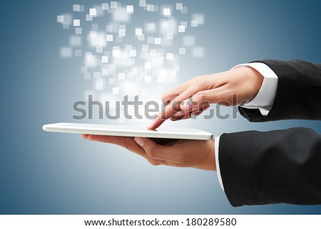 Hand of businessman on a touch tablet, business concept. - stock photo