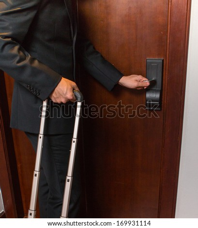 Hand of businessman open door in the hotel.