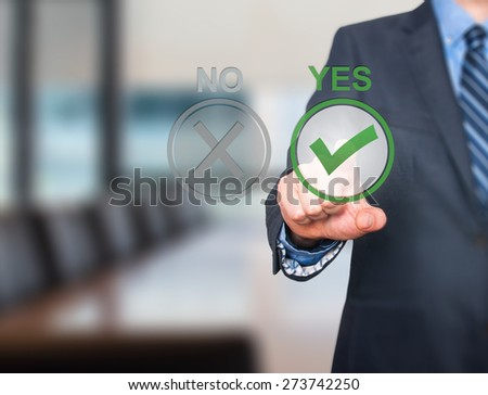 Hand of businessman press Yes button. Concept of decision making. Isolated on office. Stock Image - stock photo