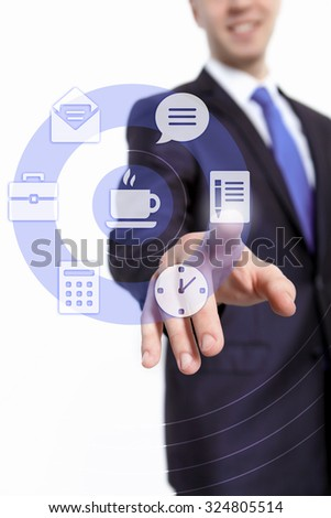 Hand of businessman pressing button on virtual screen
