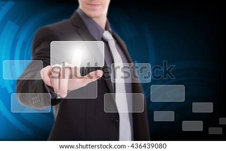 hand of businessman pushing on a touch screen interface with technology background - stock photo