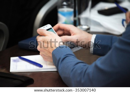 Hand of businessman, works at a conference