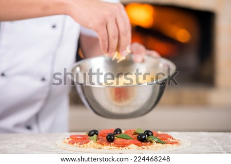 Hand of chef with plate of cheese pizza.Close-up. - stock photo