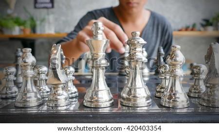 Hand of chess player  - stock photo