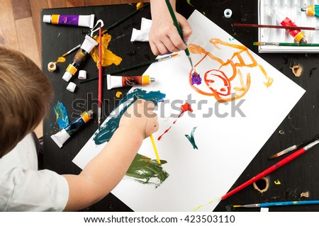 Hand of child painting - stock photo