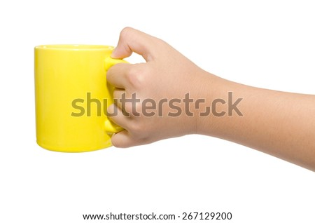 Hand of child with cup isolated on white - stock photo