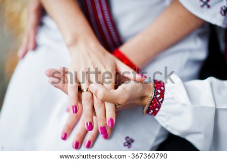 Hand of couple on traditional dress in love