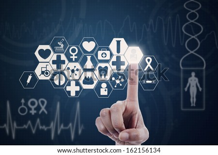 Hand of doctor pressing a button on modern medical screen - stock photo