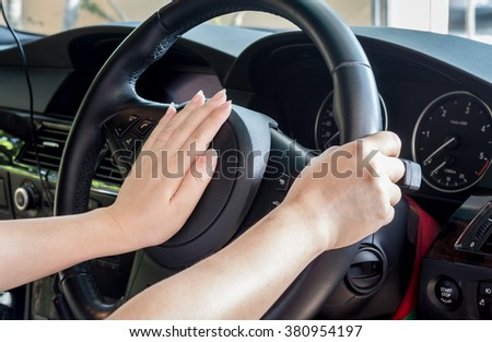 Hand of driver on steering