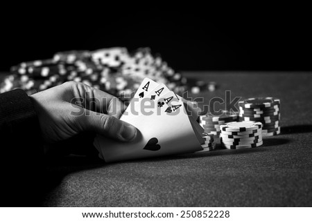 Hand of four aces in poker in black and white - stock photo