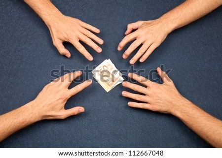 hand of four men and wad of euros on blue background - stock photo