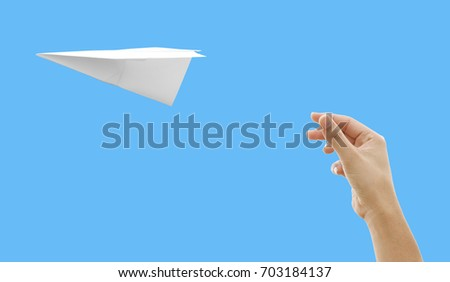 hand of girl throwing a paper airplane on the blue background, with clipping path.