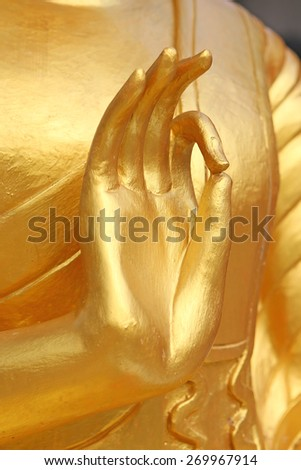 Hand of gold Buddha in Thailand - stock photo