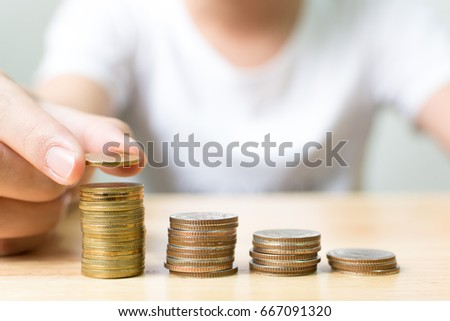 Hand of male putting gold coin stack step up growth, Financial investment and save money concept