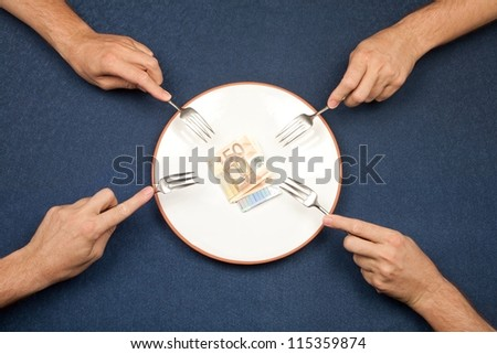 hand of man and wad of euros on white plate - stock photo
