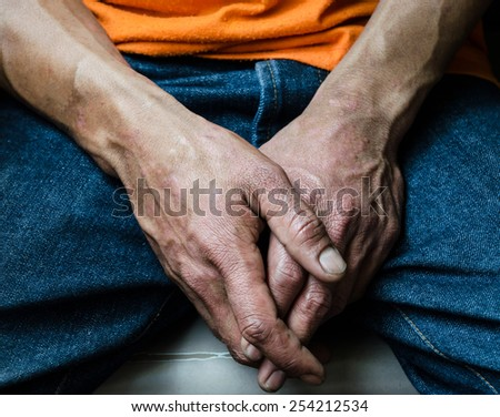 hand of man  feeling peaceful or confess to some mistake ,hand focus - stock photo