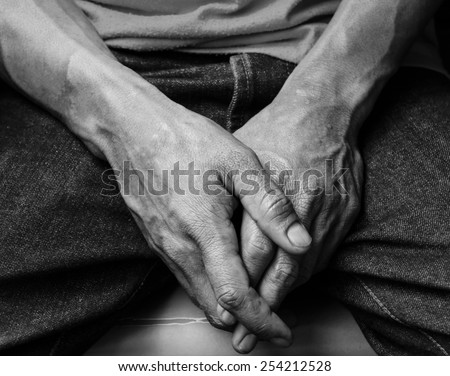 hand of man  feeling peaceful or confess to some mistake ,hand focus ,black and white  - stock photo