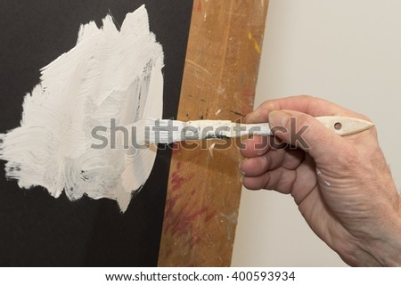 hand of man painting