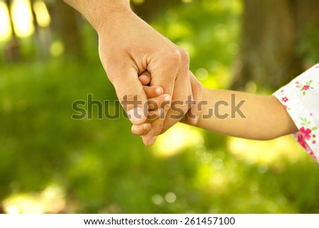 hand of parent and child - stock photo