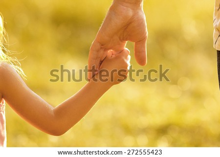 hand of parent and child